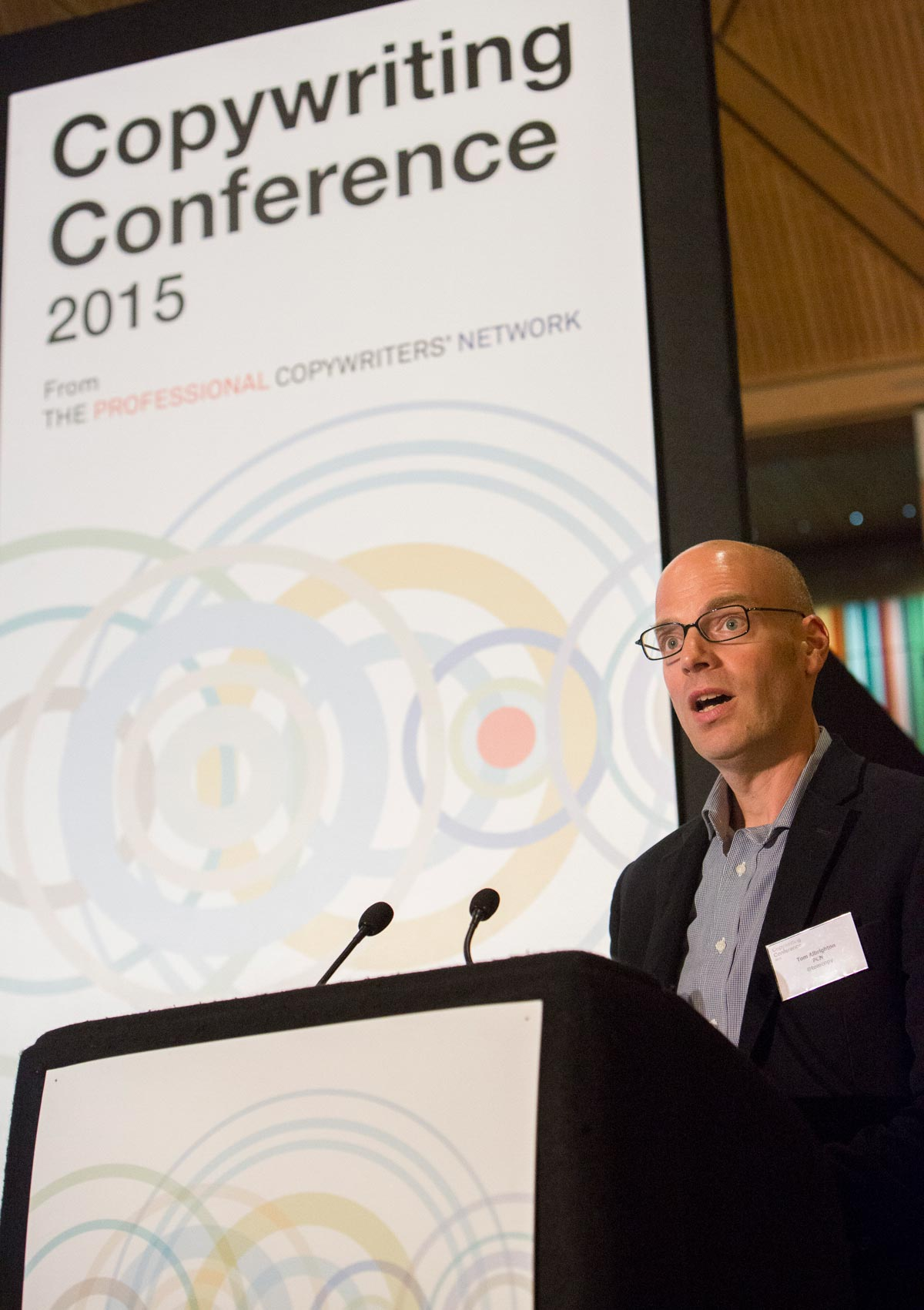 Tom speaking at conference
